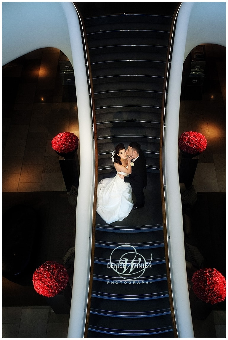 bride and groom on the stairs inside the aviator hotel