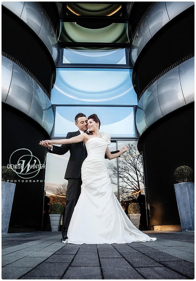 bride and groom outside the aviator hotel in farnborough