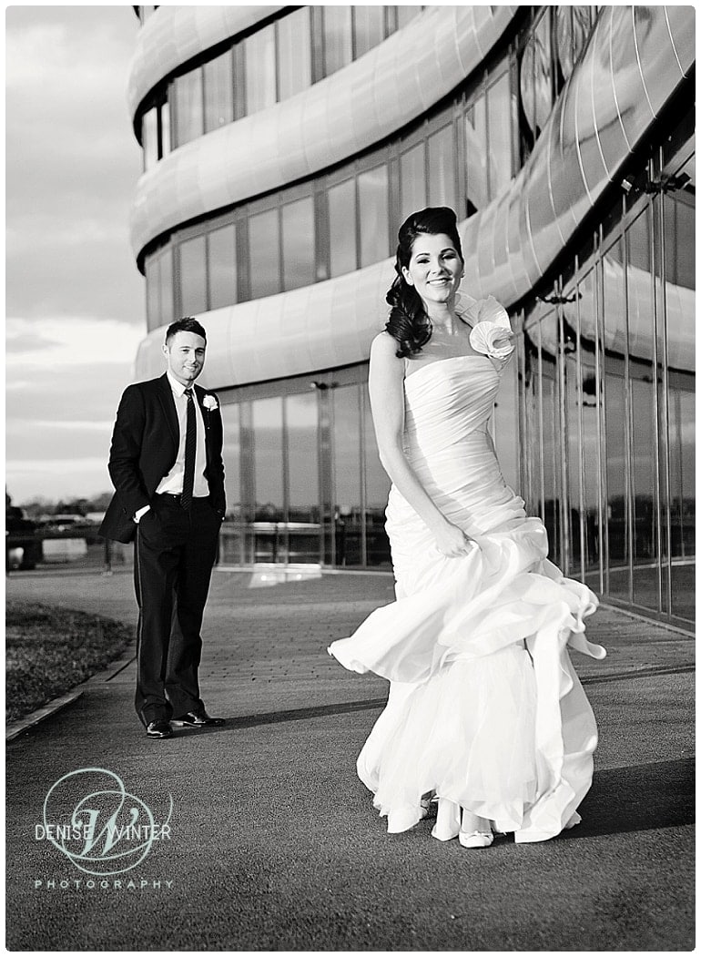 fun bride and groom photograph outside the aviator hotel in farnborough