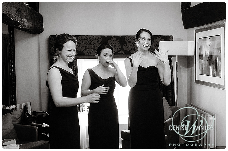Bridesmaids seeing the bride for the first time on her wedding day
