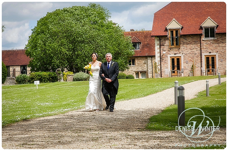 Bride walking with her father on her wedding day at the Four Pillars Hotel in Witney