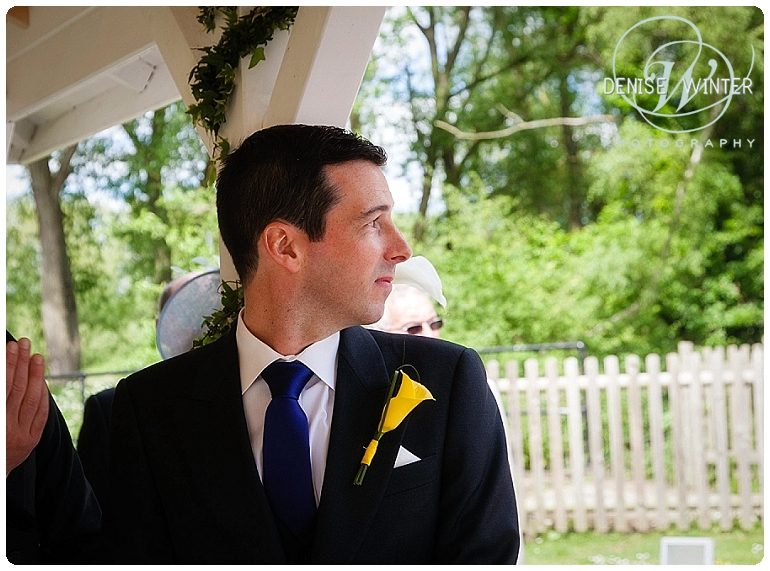 Groom lookinoxfordshire wedding photographer