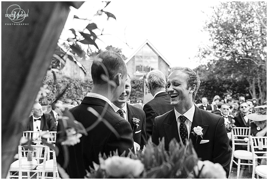 Groom laughing just before his wedding ceremony at millbridge court