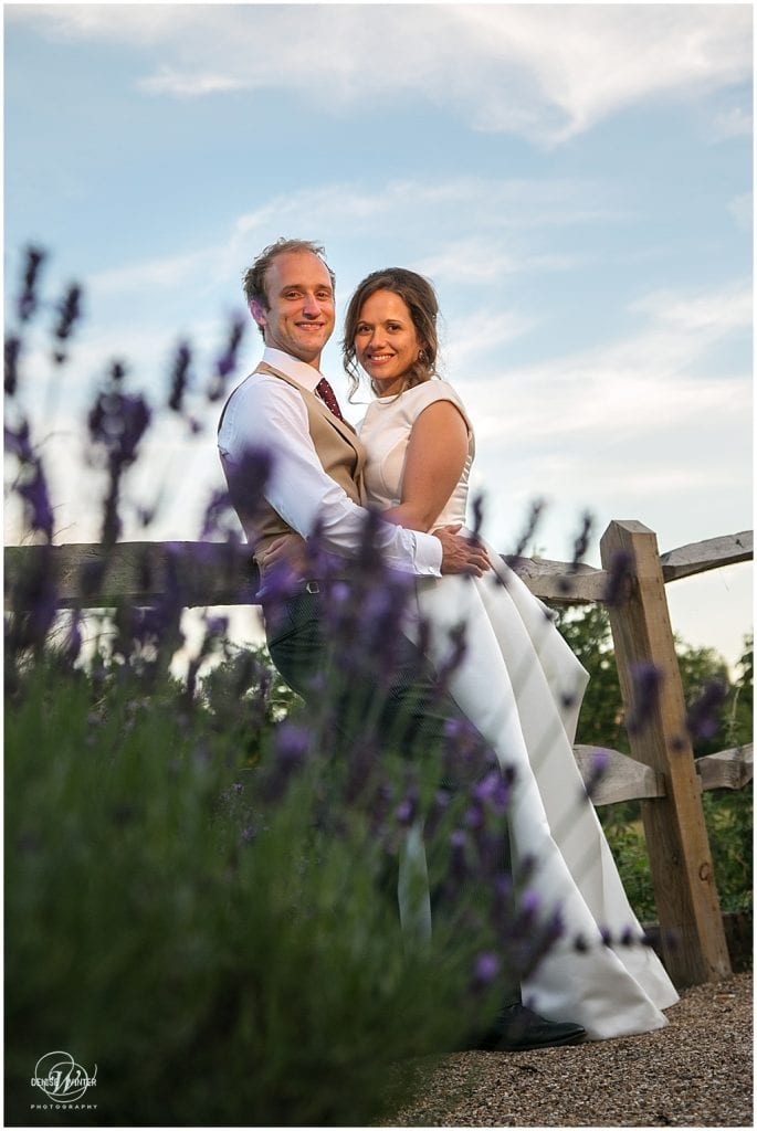 golden hour wedding photograph with bride and groom at millbridge court