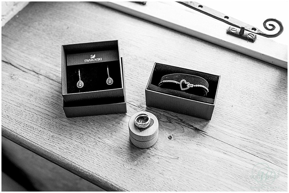 Wedding jewellery and rings on a wedding detail photo