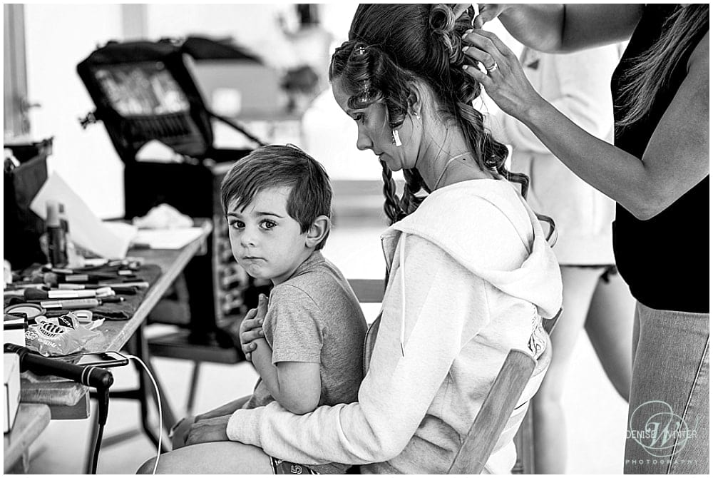 cute page boy with his aunty during bridal prep