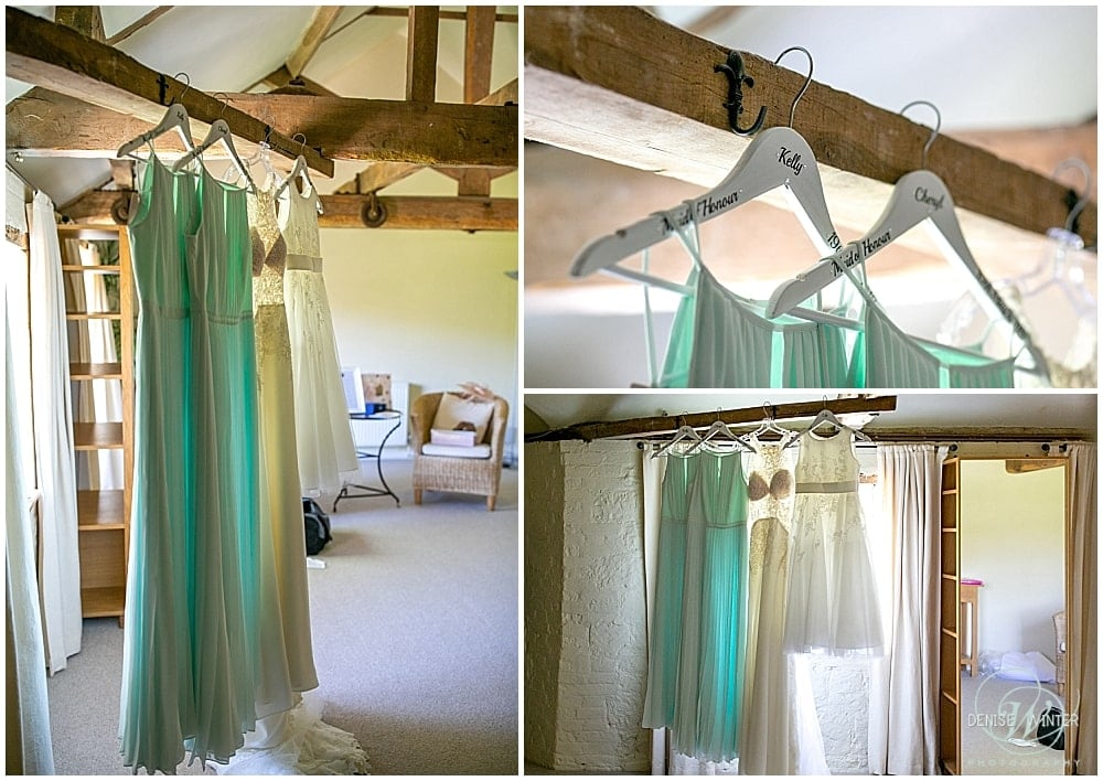 Bridesmaids dresses hanging up at Bury Court Barn on a wedding day