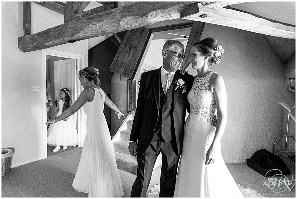 Father and his daughter on her wedding day laughing and smiling