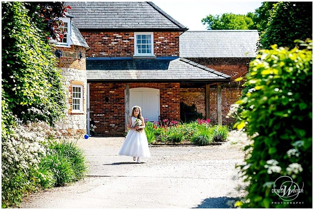 flower girl at a summer wedding at Bury Court