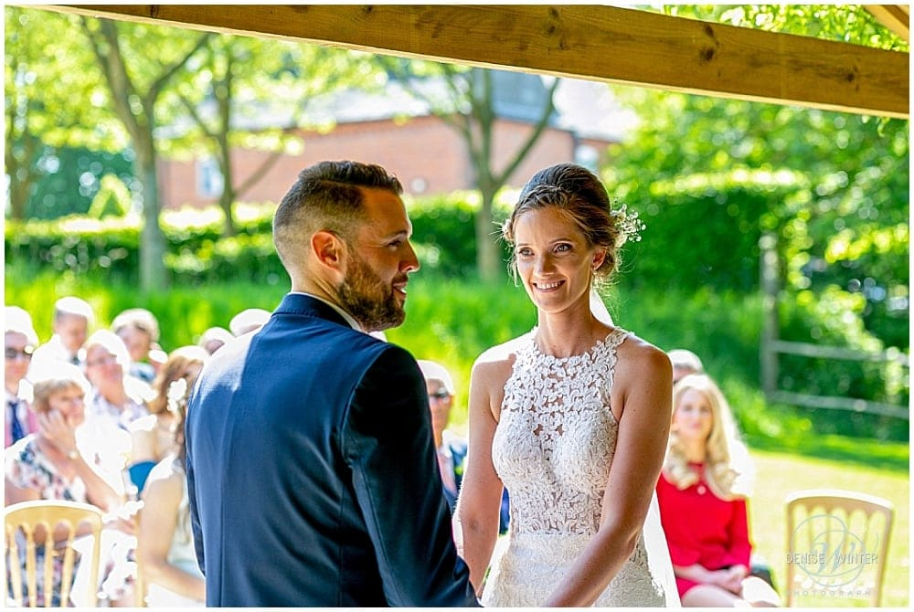 Bride and groom taking their vows at Bury Court Wedding