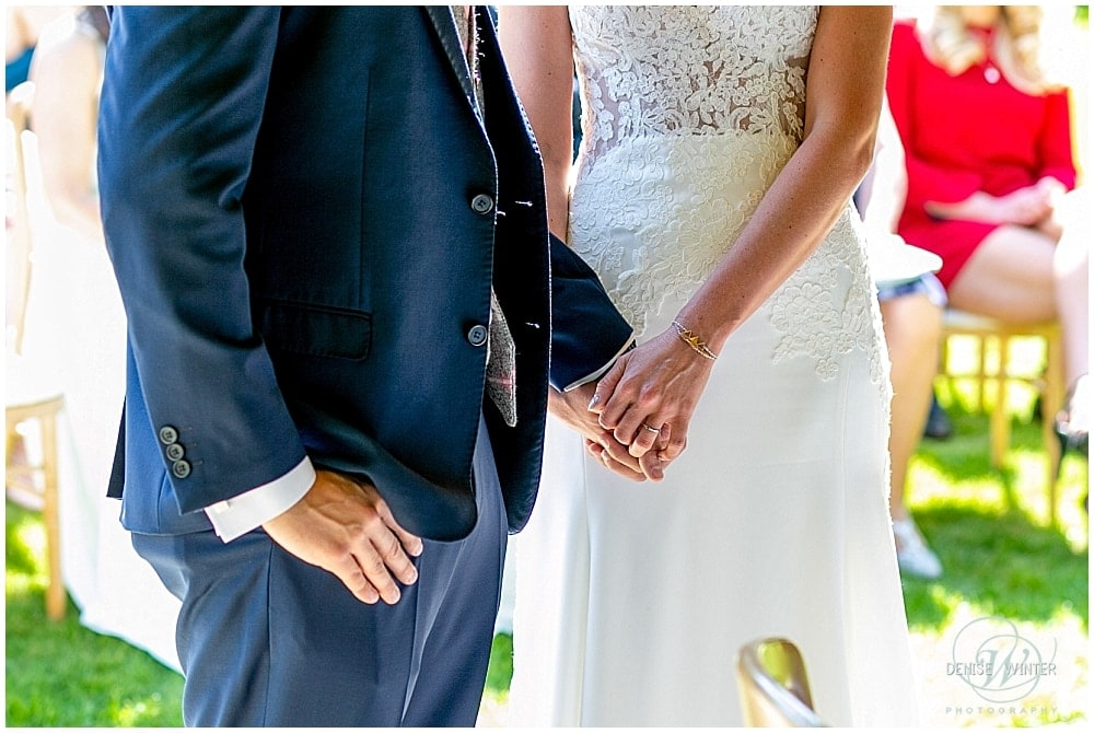 bride and groom holding hand on their wedding day