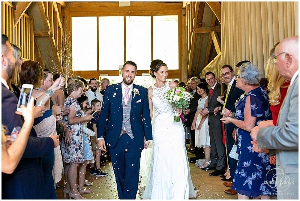 Bury Court Wedding bride and groom confetti picture