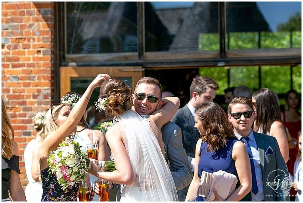 guests hugging at Bury Court Wedding
