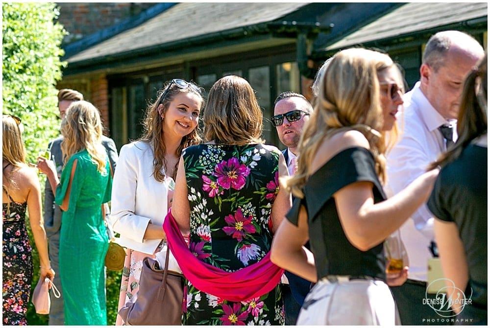 guests chatting Bury Court Wedding