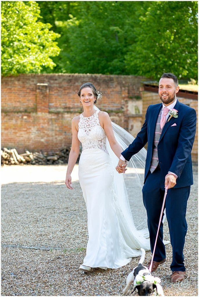 Bury Court Wedding with a bride and groom and their rescue dog