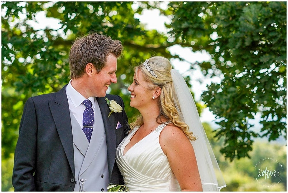 Relaxed wedding photography with bride and groom at parents home