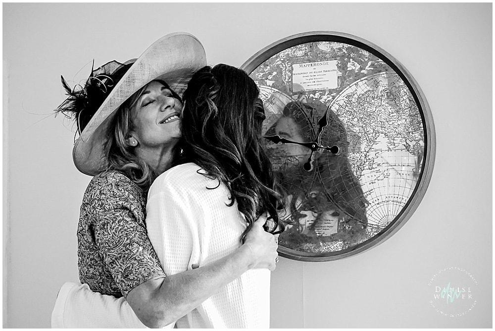 Mum hugging her daughter on her wedding day