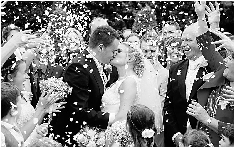 story-telling wedding photography witha  bride and groom and confetti