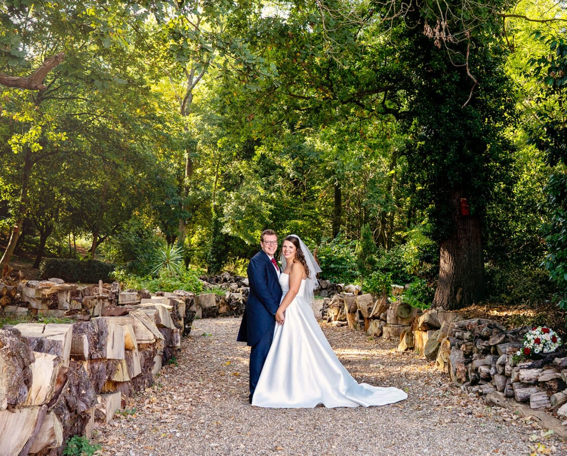 bride and groom in the woods at beaumont estate