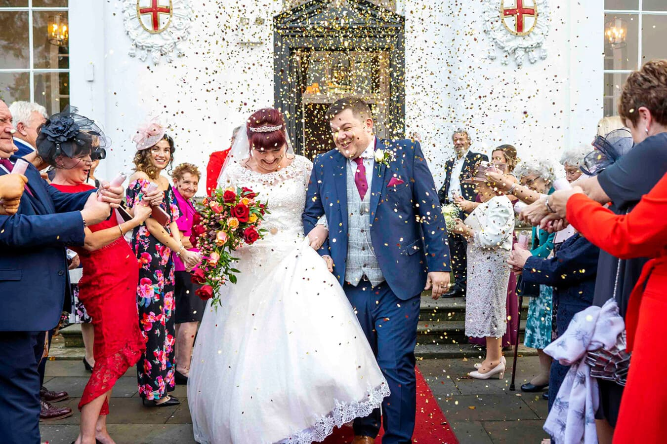 bride and groom with confetti outside beaumont estate windsor