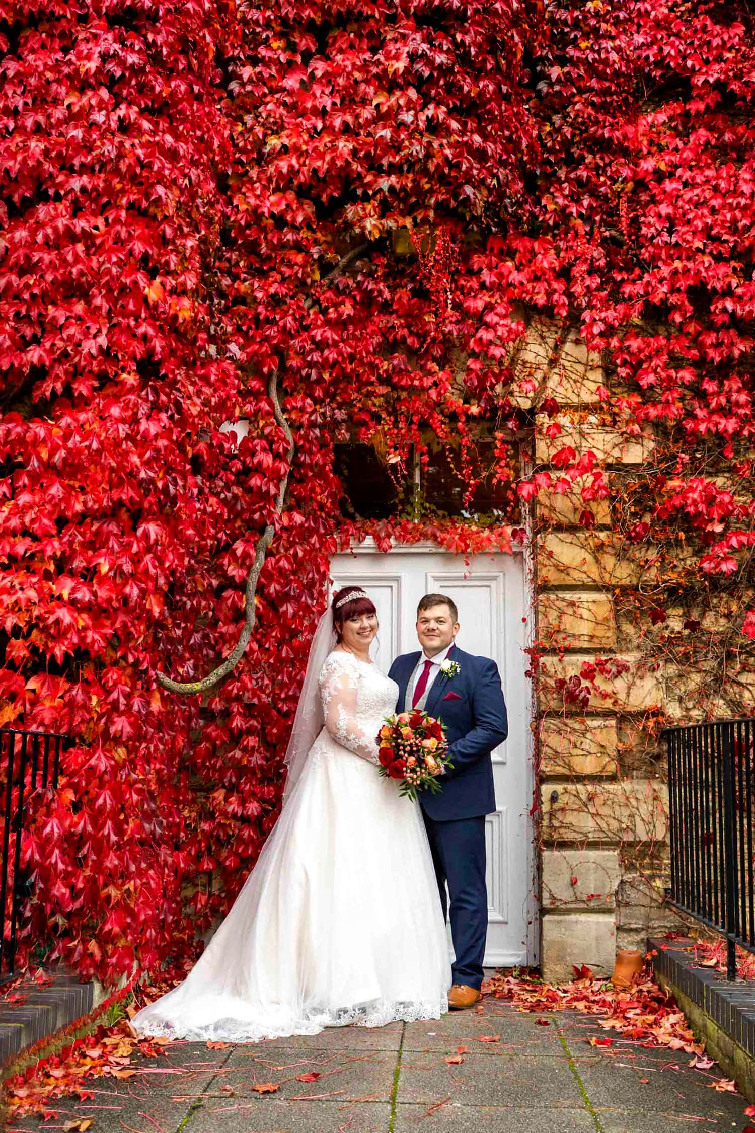 autunm colours at beaumont estate with a bride and groom on their wedding day