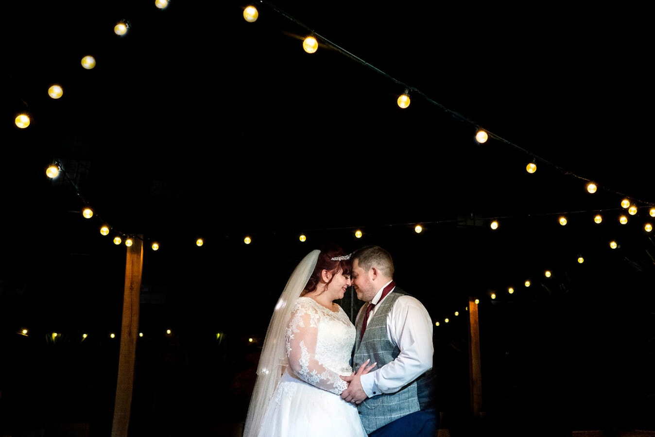 night time wedding photograph with bride and groom at Beaumont Estate