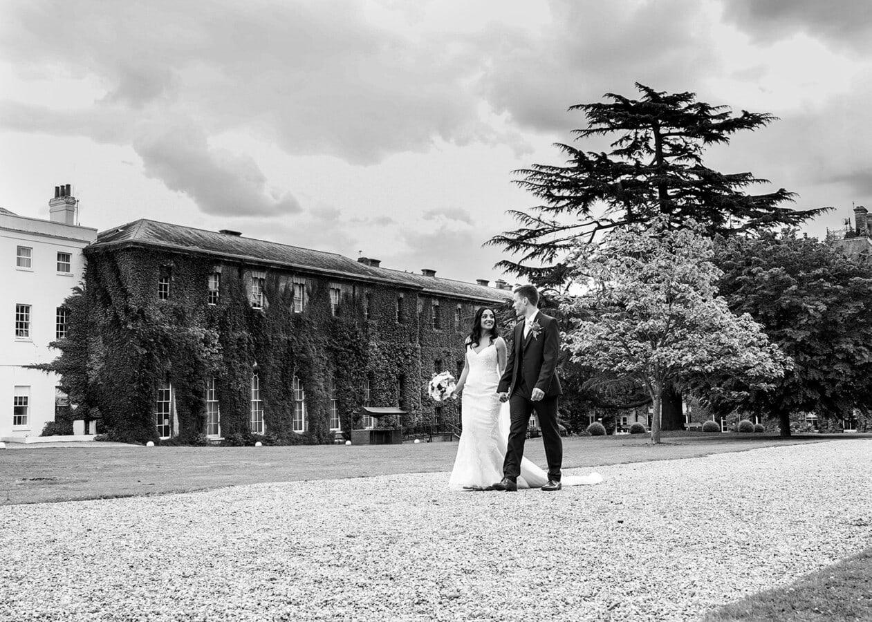 bride and groom walking outside Beaumont Estate in Windsor