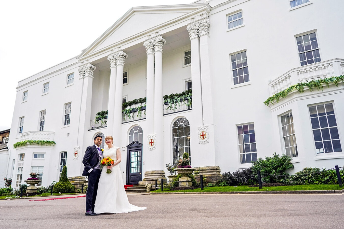 The white house at beaumont house with a bride and groom on their wedding day