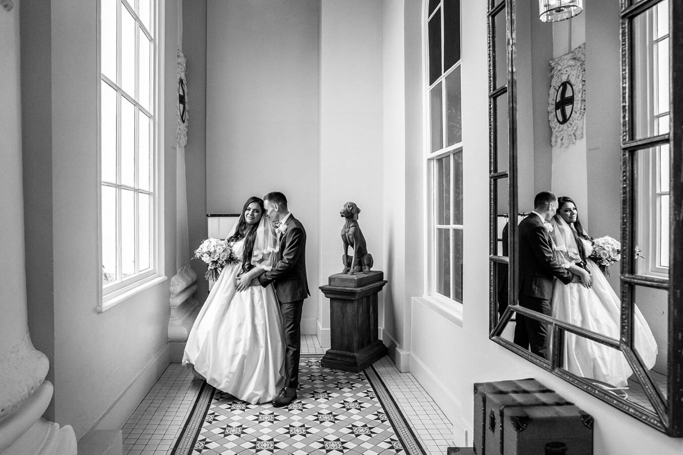 Bride and groom on their wedding day in the reception of the white house at Beaumont Estate