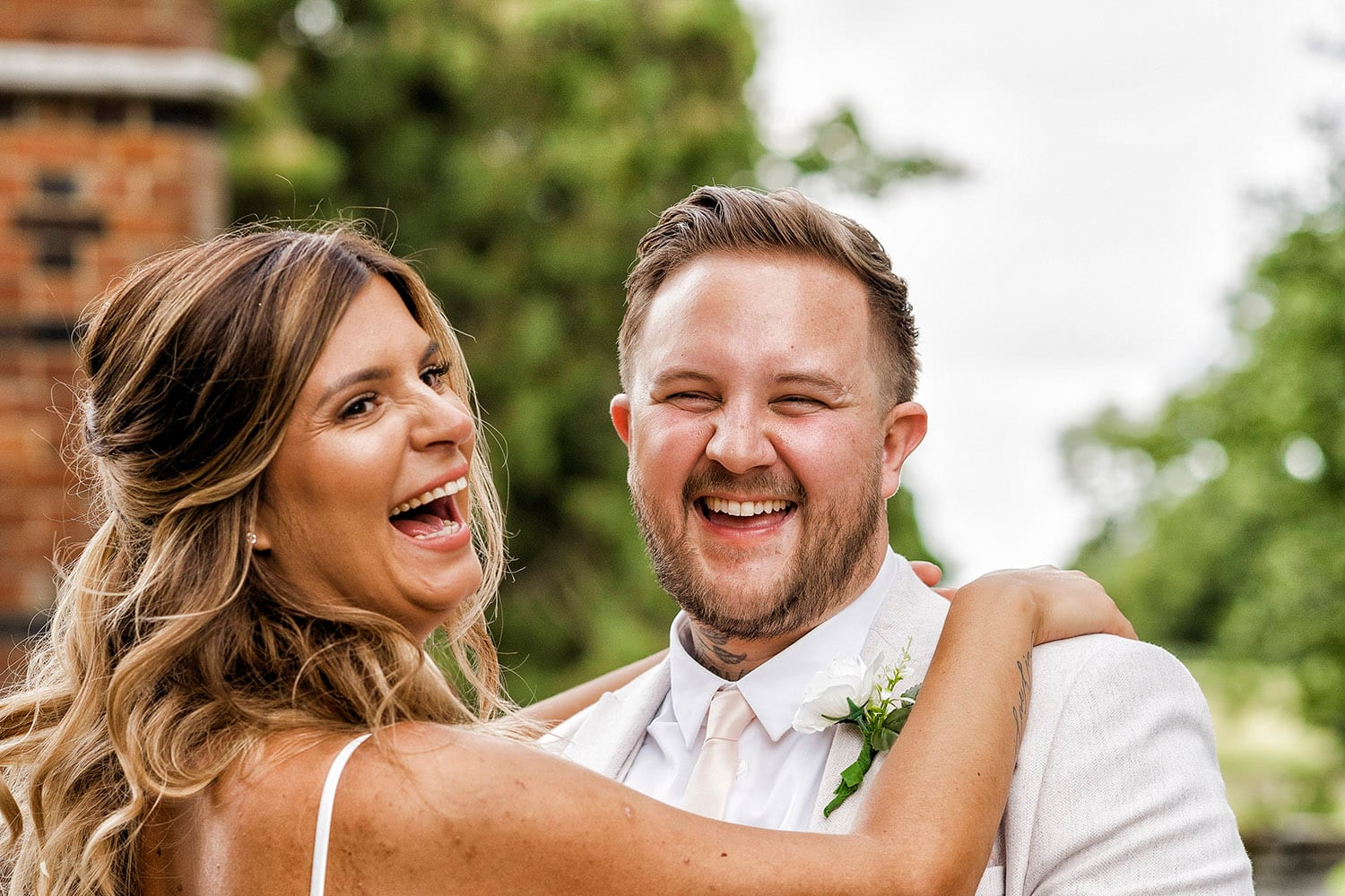 Natural smiles with a bride and groom at The Elvethem Hotel in Hampshire