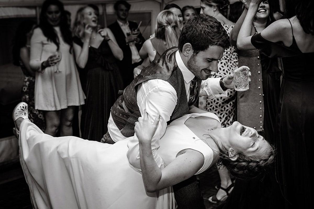 Bride and groom on the dancefloor having fun