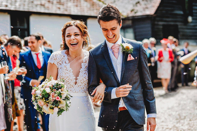 Gate street barn wedding bride and groom confetti